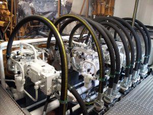 Hydraulic system on board of a dredging vessel